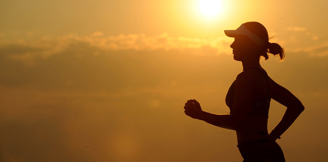 Women jogging with sunset in the background